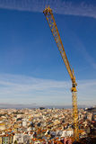 Construction Crane over ancient city Lisbon Royalty Free Stock Image