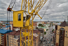 Construction crane over street traffic background Royalty Free Stock Image