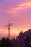 Construction crane on purple morning light Stock Photography