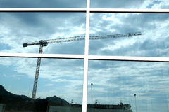 Construction crane reflection Royalty Free Stock Photos