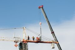 Construction crane removal. Update ed302 . Gosford. April 9, 2019. Gosford, New South Wales, Australia - April  9, 2019:  The disassembly of a tower crane from royalty free stock image