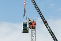 Construction crane removal. Update ed315. Gosford. April 9, 2019. Gosford, New South Wales, Australia - April 9, 2019: The disassembly of a tower crane from new stock image