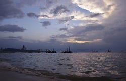 Construction crane at sea and city over sunset sky, Pattaya Thai Stock Image