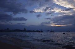 Construction crane at sea and city, Thailand Royalty Free Stock Photos