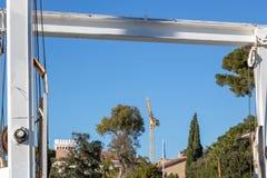 Construction crane seen through the bearing of a lifting crane of the shipyard Juan les Pins France stock photos