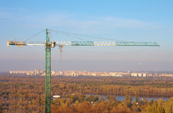 Construction crane with sky and city houses Royalty Free Stock Photos