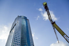 Skyscraper & Crane Royalty Free Stock Photos