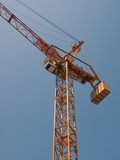 A construction crane soars into blue sky Royalty Free Stock Images