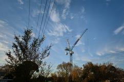Construction crane in a suburban setting. royalty free stock photos