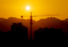 Construction crane at sunset Stock Photography