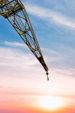 Construction crane at sunset Stock Images