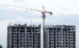 Construction crane at sunset Stock Photo
