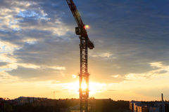 Construction crane with sunset Royalty Free Stock Image