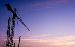 Construction crane at sunset. Royalty Free Stock Photography