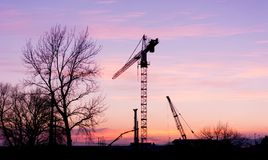 Construction crane at sunset. Royalty Free Stock Image