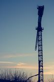 Construction crane at sunset. Stock Photography