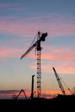 Construction crane at sunset. Royalty Free Stock Photos