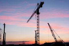 Construction crane at sunset. Royalty Free Stock Photo