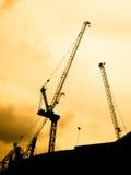 Construction crane. The construction crane on sunset siluate background Stock Image