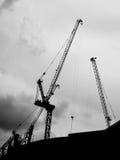 Construction crane. The construction crane on sunset siluate background Stock Photos