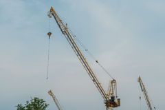Construction crane tower against a blue sky Royalty Free Stock Images