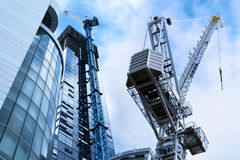 Construction Crane. Two construction cranes and new glass fronted modern buildings