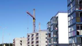 Construction crane at work stock video