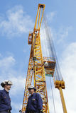 Construction crane with workers Stock Images
