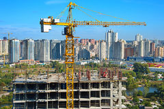 Construction crane and workers Stock Photography