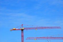 Construction Cranes. Heavy construction cranes at a job site Stock Photo