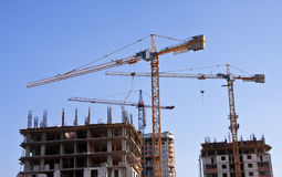 Construction cranes. Industrial landscape with construction cranes Royalty Free Stock Photo