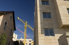 Construction cranes. General view of new buildings being constructed stock images