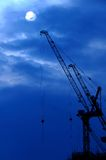 Construction Cranes. At rest, on a cool blue sky backdrop Royalty Free Stock Photos