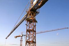 Construction cranes. On blue sky stock photography