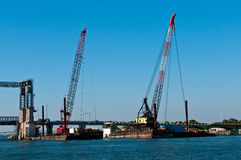 Construction cranes. Constructions cranes in the river port working Stock Photo
