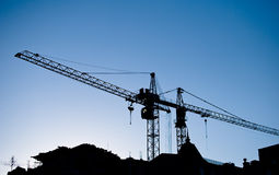 Construction cranes above roofs Royalty Free Stock Image