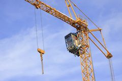 Construction cranes against the blue sky Stock Image