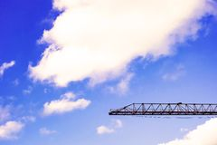 Construction cranes against the bly sky background, royalty free stock images