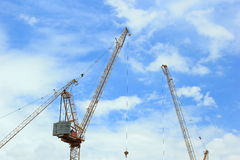 Construction cranes for architectural and engineering work Stock Photos