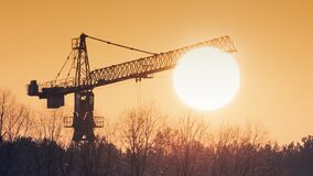 Free Construction Cranes At Dawn In The Morning Mist Stock Images - 211860444