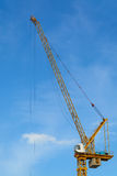 Construction cranes with blue sky Stock Images