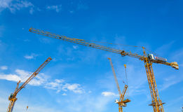 Construction cranes with blue sky Royalty Free Stock Photos
