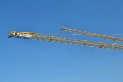 Construction cranes. The boom of construction cranes at construction site Royalty Free Stock Photography