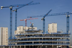 Construction Cranes Building An Office Development Royalty Free Stock Image
