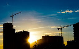 Construction cranes and building silhouettes Stock Images
