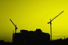 Construction cranes and building silhouettes Royalty Free Stock Photography