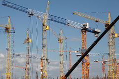 Construction cranes at building site Royalty Free Stock Image