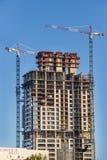 Construction cranes building skyscraper. Johannesburg, South Africa - March 8, 2018: Construction cranes building skyscraper Stock Image