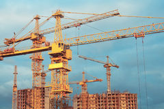Construction cranes and bulding. Site with construction cranes and bulding Royalty Free Stock Photography