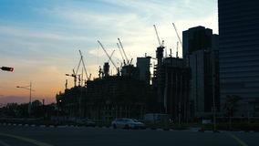 Construction cranes and car traffic on road timelapse - 4k stock video footage